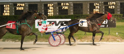 Lindy's Big Bang (Ridge Warren) held off his fast closing stable-mate Call Jot Justice in last week's Open Trot. The two Terry Leonard trained horses will square-off again in tonight's sixth race feature. (Four Footed Fotos)