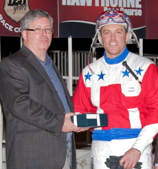 Casey Leonard was Hawthorne's leading driver in 2016 and is shown here accepting the award from Hawthorne's Assistant General Manager John Walsh.. (Four Footed Photo)