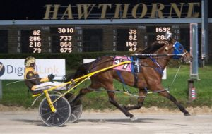 Evergreen Elite (Mike Oosting) won last night's $15,000 Open Pace Handicap with authority. (Four Footed Photo).
