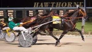 Coal Hanover is shown winning last week's $15,000 Open Pace with Jim Lackey who is back at his lines Friday night. (Four Footed Photo)