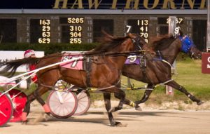 OJ Heavenly (Casey Leonard) held off Fresh Squeeze (No. 7, Ridge Warren) by a neck in Saturday's $15,000 Filly and Mare Open Pace. (Four Footed Photo).