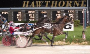 John Barnard's Heza Real Shooter guns for his second straight win in tonight's second race. (Four Footed Photo).