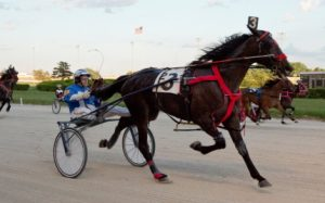 Topville Avatar (Dale Hiteman) is shown in what has become a familiar finish at Hawthorne for the Joel Smith trained trotter. (Four Footed Photo)