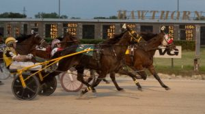 Trashytonguetalker (Casey Leonard) held off the late-charging 50-1 longshot (Bob Smolin) in Friday's $15,000 Open Pace. (Four Footed Photo).
