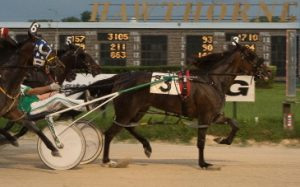 Fox Valley Dandy (Jim Lackey) was the surprise $17.00 winner in last night's second division of the Plum Peachy stake series for ICF 3-year-old fillies. (Four Footed Photo)