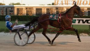 Fox Valley Reggie (Tyler Shehan) is shown here  winning his Cardinal Pace elimination. (Four Footed Photo)