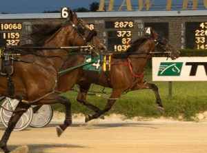 Ima Skydancer (No. 4, Tim Curtin) nosed-out Mississippi Rabbit (No. 6) in a Cardinal pace elimination last weekend. (Four Footed Photo).