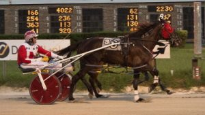 Friday's second 3-year-old Cardinal pace elimination was so close it you can barely tell A Real Dozzie is inside of the winner Lady Party (Casey Leonard) at the finish in this Four Footed Photo.