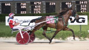 Rollin Coal (Casey Leonard) stayed unbeaten through three career starts with her win in last night's $28,600 Violet Final for for ICF pacing fillies. (Four Footed Photo).