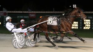 Tonight's Open Pace favorite Let's Drink On It won the 2013 American National as a 2-year-old with driver Brian Sears. (REB Photo)
