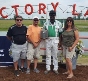 Jamaica Oatton was awarded a plaque at the Du Quoin State Fair honoring him as the 2017 Illinois Country County Fair leading driver by the IHHA's Tony Somone, Mike Knicley and Brenda Watson. (Photo courtesy of Josh Carter)