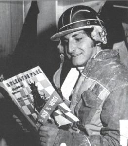 A young Carl Porcelli Jr. studies an Arlington Park harness racing program. (Arlington Park Photo)