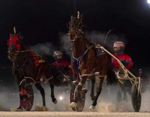 C Far (right), trained and driven by Gary Rath, got past Lacarmeliliana (Matt Avenatti) in deep stretch in the first keg of the Tim Wilson Sr. Late Closer. The two ICF mares, and eight others, square off in round two tonight. (Four Footed Photo).