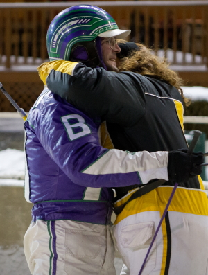 Driver Brandon Bates earned a big hug from trainer Kim Roth after guiding Sagebrush Shocker to his win in Saturday's $25,000 Terry Hunt Late Closer Final. (Four Footed Photo)