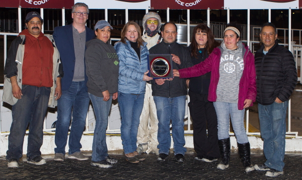 "Loralee Johnson (blue jacket) was honored on closing night as Hawthorne's leading trainer at the winter meet. She was joined by her ""blue collar"" team of workers, owners, and friends. (Four Footed Photo)"