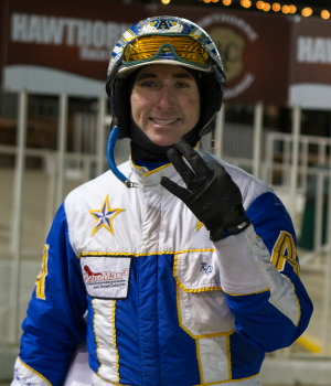 Ryan Anderson holds up three fingers to indicate he reached the 3,000 plateau in career winning drives last night at Hawthorne. (Four Footed Photo)