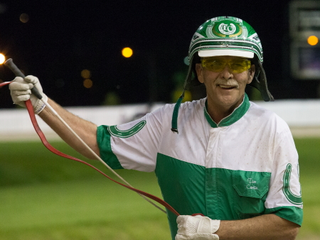 Driver Tim Curtin had a big smile on his face after guiding the Mike Brink Stable's Allbeastnobeauty to her1:53.3 victory in Saturday's first Plum Peachy stake series division for ICF 3-year-old filly pacers. (Four Footed Fotos)