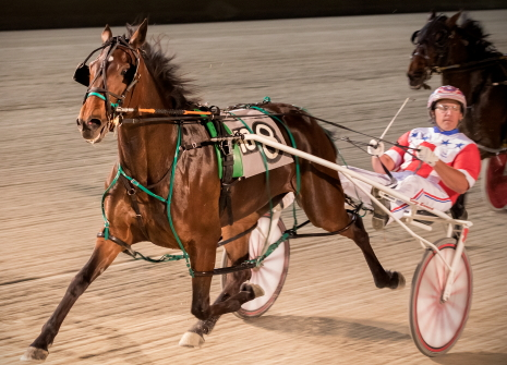 Rollin Coal rolled to her Plum Peachy stake series win with Casey Leonard last week and now sets her sights on the first division of tonight's Violet pacing filly stake. (Four Footed Fotos)