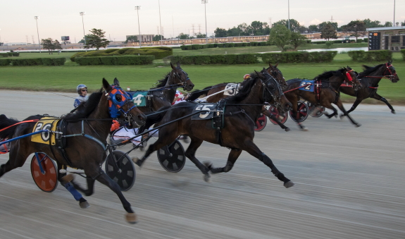 Unlike this recent start of a race at Hawthorne for older horses, this week it'll be 2-year-old pacers and trotters sprinting out for position in the Cardinal and Violet stakes. (Four Footed Fotos)
