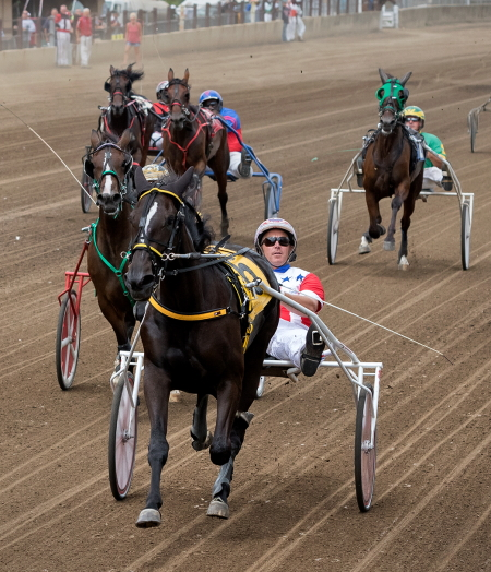 Encantado (Casey Leonard) is shown here pulling away from the field in her Springfield championship for ICF 2-year-old trotting fillies. (Four Footed Fotos)