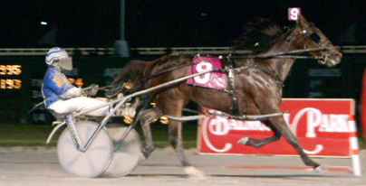 Driver Dale Hiteman guided the 2-year-old filly pacer Kikikatie to her victory in her $100,000 American National in 2003.  (R.E.B. Photo)