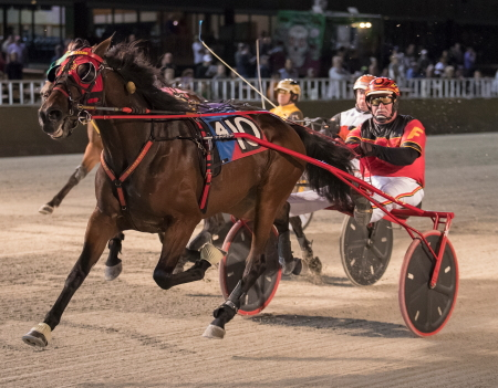 A determined Trixie's Turbo (John D Finn) rolled to her third straight win when she captured the $119,470 Kadabra Championship for ICF 3-year-old trotting colts and geldings. (Four Footed Fotos)
