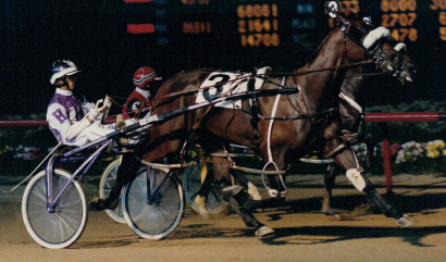 Illinois Harness Hall of Fame pacer Gosox is shown here as a 2-year-old with driver, trainer and co-owner Lavern Hostetler winning the 1989 Orange & Blue Colt Championship at Sportsman's Park. (Pete Luongo Photo)
