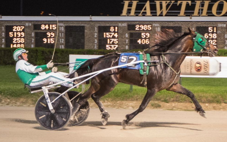 Lourhianon (Tim Curtin) looks to make it five consecutive victories at Hawthorne in Sunday's second Cardinal stake division for ICF trotting colts and geldings. (Four Footed Fotos)