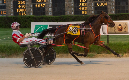 Double Parked (Travis Seekman) is shown here pulling away to a victory in a division of the recent Violet stake for ICF freshman pacing fillies. (Four Footed Fotos)