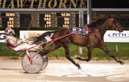 Heidi High pulled off an upset in last Sunday's second round of the Beulah Dygert 3-year-old ICF filly trot with driver Juan Franco. (Four Footed Fotos)