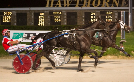 In his first Hawthorne start a week ago Stuckey Dote (No. 5, Casey Leonard) finished second to his Terry Leonard trained stable-mate Ponda's Prospect (inside with Ridge Warren). Four Footed Fotos)