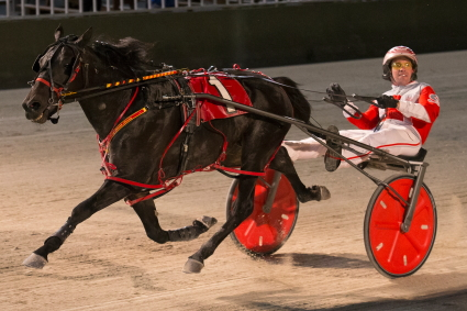 The Perry Smith stable's Dakota Roadster (Travis Seekman) goes to the gate in Friday night's featured fifth race. (Four Footed Fotos)