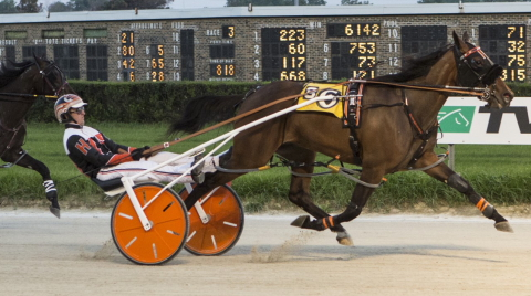 Recent Incredible Tillie series winner Fox Valley Exploit (Kyle Husted) goes postward at Springfield today in the first division of the ICF two-year-old filly pace stake elimination. (Four Footed Fotos)