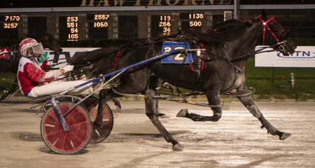 The Rick Schrock trained Foolishlittlegirl (Casey Leonard) came splashing down the lane to take Sunday night's the $15,000 Plum Peachy Consolation for state-bred three-year-old pacing fillies. (Four Footed Fotos)