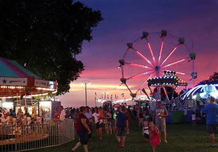 Night time approaches at the Clinton County Fair. Photo courtesy of visitclintoncounty.com