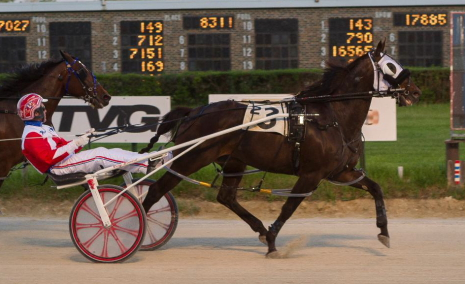 Last season's ICF 3-year-old champion Fox Valley Triton (Casey Leonard) goes to the gate in Friday night's eighth race headliner. (Four Footed Fotos)
