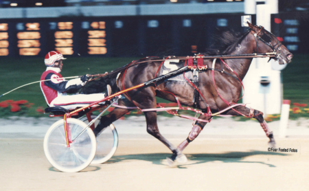 Fox Valley Memory (Dave Magee) is shown winning on Super Night 1997 at old Sportsman's Park. (Pete Luongo Photo)