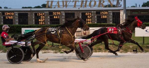 RG's Tracer (No. 1) and Mighty Tony Mac (Np. 5), the one-two finishers in a $21,450 division of last week's Cardinal Pace, will be back in action this week. RG's Tracer competes Friday night in round two of the Incredible Finale Stake Series for ICF three-year-old pacing colts and geldings. (Four Footed Fotos)