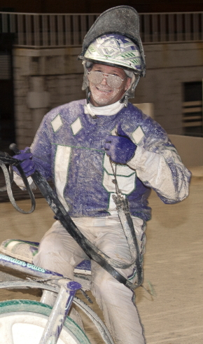 """A smiling Brando Bates gave the track photographer a """"thumbs up"""" after notching his 1,000 career driving victory last Sunday with the ICF 3-year-old trotting filly Fox Valley Extacy in a leg of the Beulah Dygert stake series. (Four Footed Fotos)"""