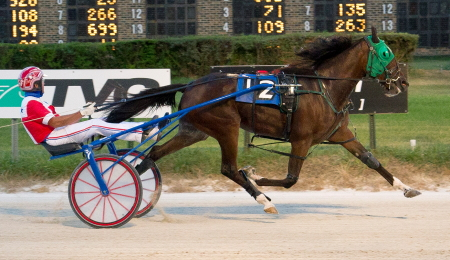 The Steve Searle trained freshman filly Loulita (Casey Leonard) puts a three-race winning streak on the line in tonight's $29,000 Shawnee trotting stake. (Four Footed Fotos)