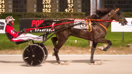 The Mike Brink stable's Fistfullofdollars (Kyle Wilfong) proved best in the $118,000 Kadabra final for ICF freshman trotting colts and geldings. (Four Footed Fotos)